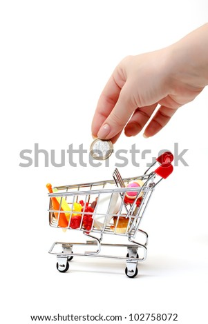 Shopping Cart with Hand and Coin on white background
