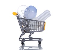 Shopping cart with light bulbs inside (isolated on white)