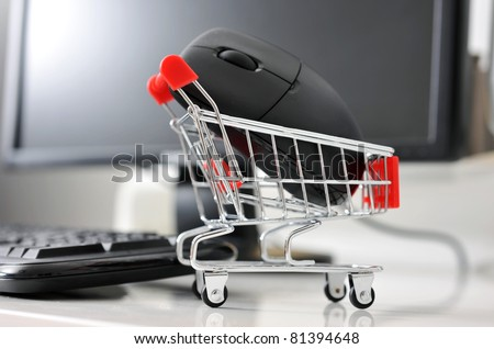 shopping cart with mouse in front of computer , online shopping concept.