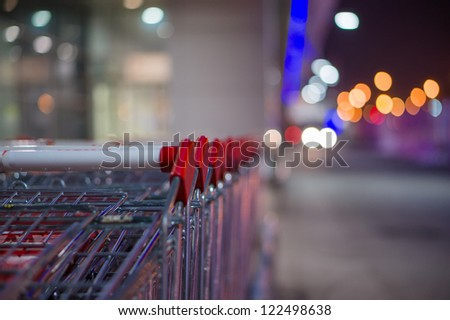 Shopping carts at the entrance of supermarket in evening