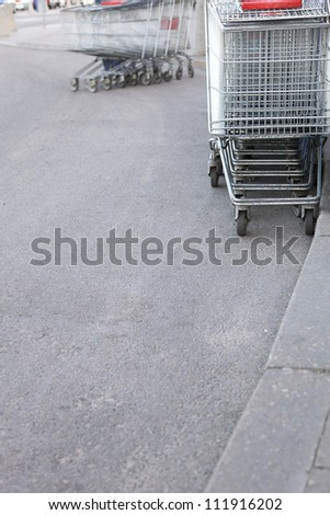 shopping carts, basket, outdoor footpath background - stock photo