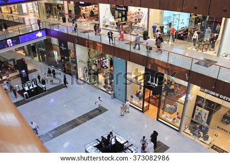 shopping center Dubai Mall, top view inside, boutiques and people make purchases, United Arab Emirates April 14, 2014, soft focus