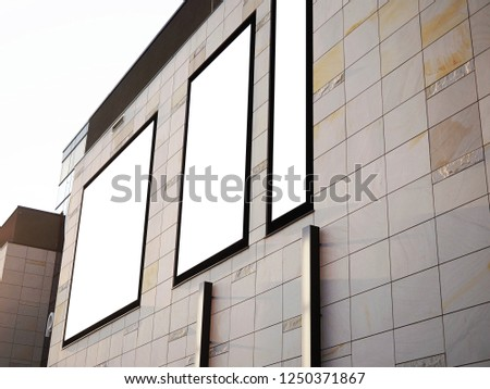 Shopping centre mall, airport, train station office building facade, Blank white paper board at modern wall texture background, Mock up ads template, Business presentation content concept. #1250371867