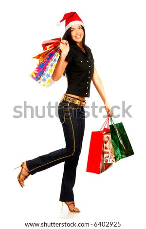 Shopping Christmas woman smiling. Isolated over white background