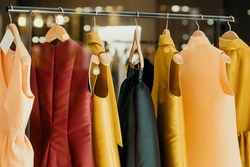 shopping concept - colorful clothing in a fancy store