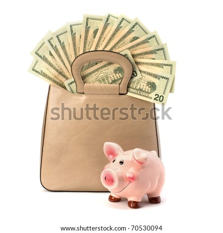 Shopping concept. Handbag full with money isolated on white background.