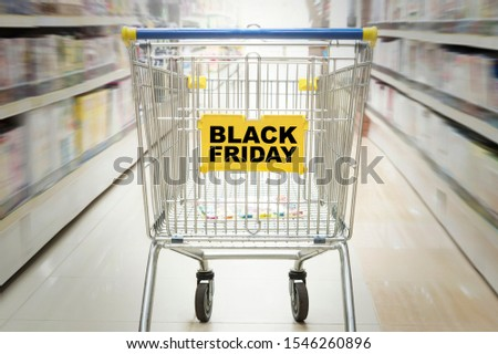 Shopping concept in supermarket for fast consumer lifestyle. Toy store, Bookstore, household and household goods. inscription black Friday. counter in the supermarket with effect of movement #1546260896
