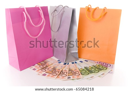 Shopping concept - Many colorful shopping bags with euro banknotes