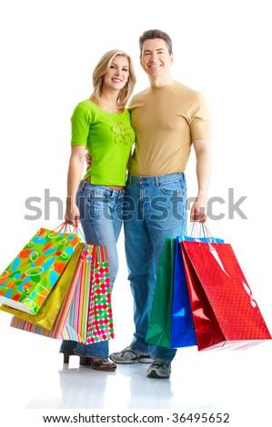 Shopping  couple  smiling. Isolated over white background