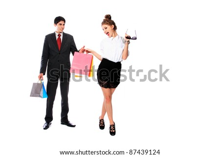 Shopping couple smiling. Isolated over white background