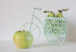 Shopping gar full of apple. Concept of choice.