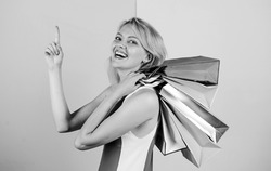 Shopping happiness. present packages for holiday preparation. summer discount. special offer on black friday. shop closeout. happy woman shopper. big sale. female shopaholic hold shopping bags.