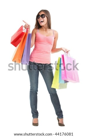 Shopping happy woman gesturing showing copy space at the side. Full length isolated on white background.