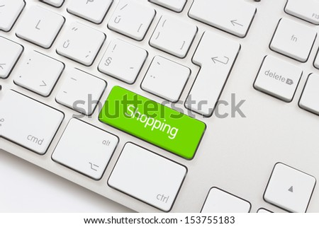 Shopping key on a white keyboard