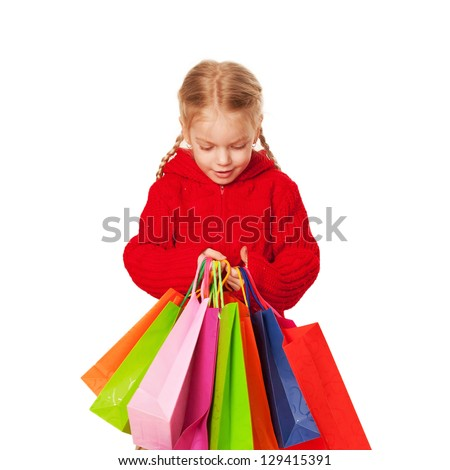 Shopping little girl in red holding a many shopping bags. Sale or discount concept  Isolated on white background