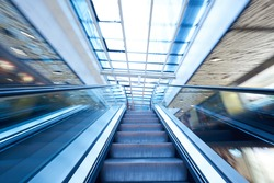 Shopping mall center escalators. Zoom blur movement.