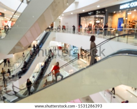 shopping Mall escalator blurred. Blurred motion demonstrates the speed #1531286393