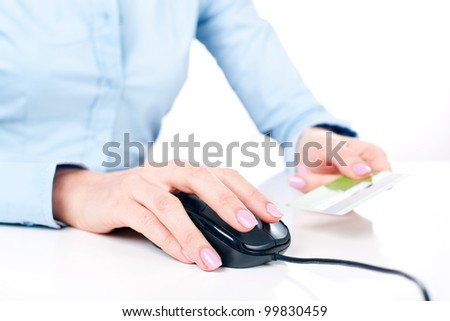 Shopping on-line, female hands holding credit card, closeup