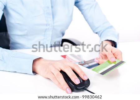 Shopping on-line, female hands holding credit card, closeup - stock photo