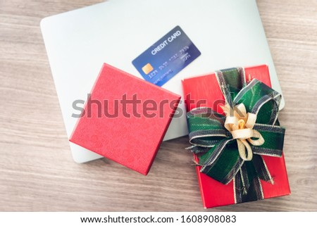 Shopping Online and Holiday Celebration Concept, Present Gift Box and Credit Card on Laptop. Celebrate Anniversary Greeting Presents Event