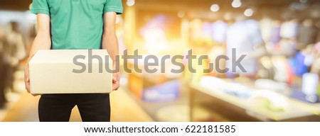 Shutterstock shopping online  and order concept,male postal delivery courier   package to home ,Products and services fashion clothing.for banner your can ad text for advertising