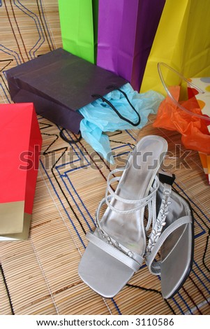 Shopping parcels and womans shoes lying on the ground after spending spree
