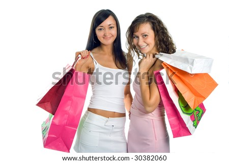 shopping peauty girlfriend with colored package over white background