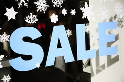 shopping sale with snowflakes on the window, selective focus
