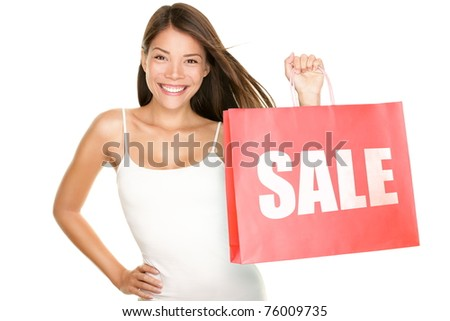 Shopping sale woman showing shopping bag with sale written. Beautiful smiling asian woman showing red shopping bags. Mixed Chinese Asian Caucasian female model isolated on white background.
