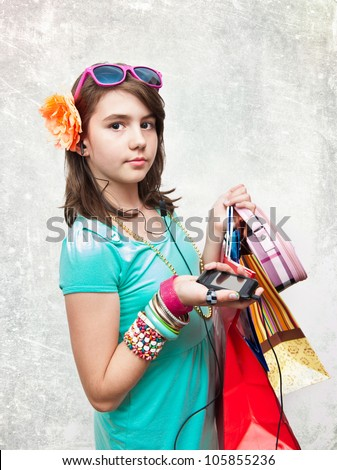 Shopping. Shopping teen girl excited and wondered. Dynamic image of teen girl with shopping bags. Isolated on white background.