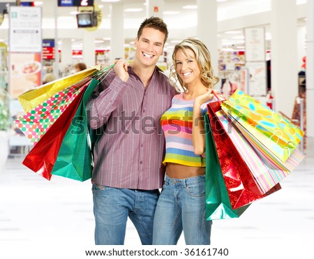 Shopping  smile couple at the mall - stock photo