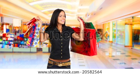 Shopping smiling woman in the mall