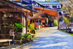 Shopping street in rural historic village Ohara near Kyoto in Japanese mountains around historic buddhist temples. Souvenir stores and local food cafes wait for customers.