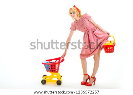 Shopping therapy in action. What do you think about this one. happy retro woman go shopping. Delighted woman shopping online. products with best quality here. consumerism and people concept.