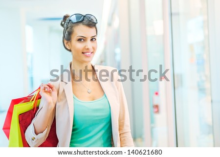 Shopping time, attractive woman at mall