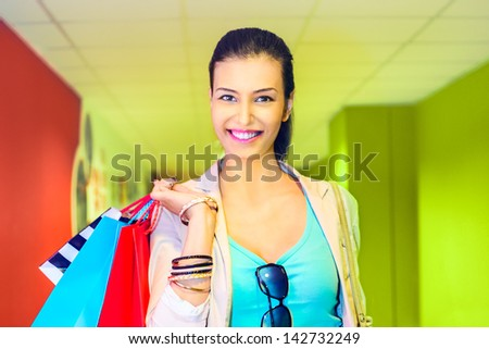 Shopping time, young woman at mall