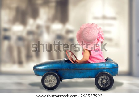 shopping tour, pink dressed Little girl driving big vintage old toy car and having fun