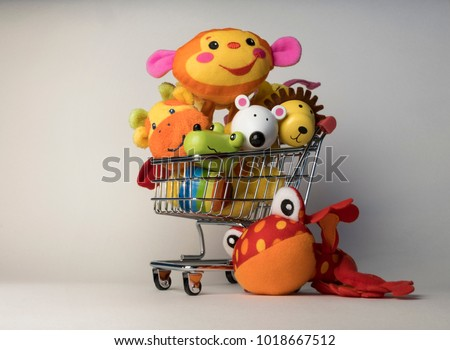 Shopping trolley cart with toys inside, cost of having a child, cute faces #1018667512