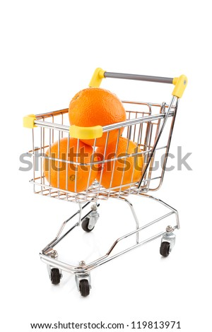 Shopping trolley full of oranges on white background