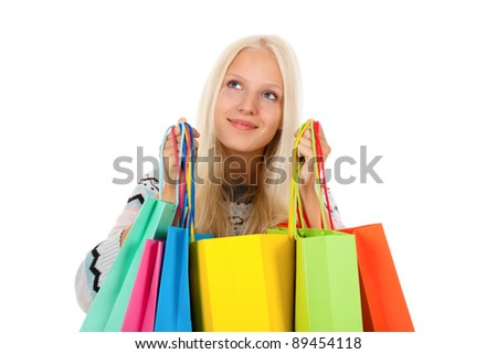 shopping woman happy excited smiling holding bags, looking up to empty copy space, wear winter knitted sweater, isolated over white background isolated on white background.