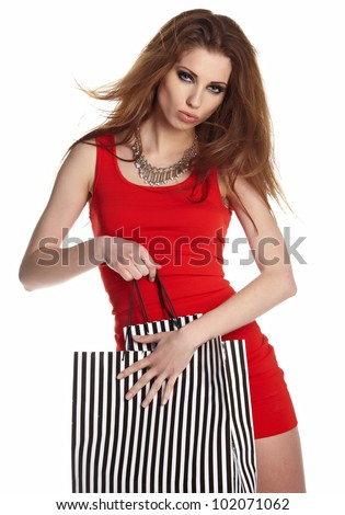 Shopping woman happy smiling holding shopping bags isolated on white background.