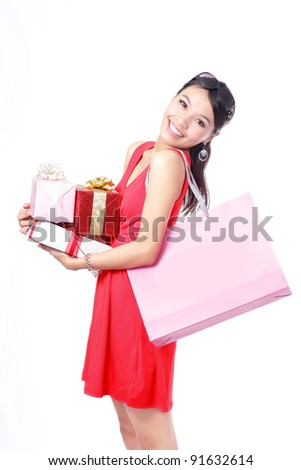 Shopping woman happy take big shopping bag and gift isolated on white background, model is a asian beauty