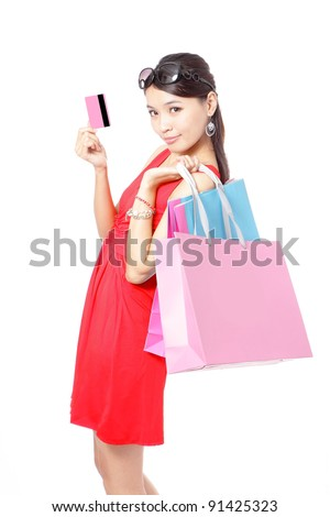 Shopping woman happy take credit card and shopping bag isolated on white background, model is a asian beauty