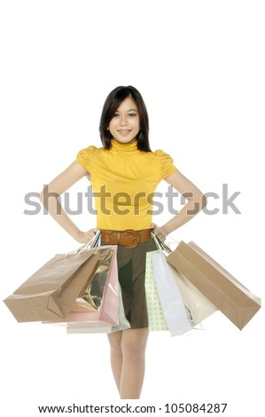Shopping woman hold bags isolated over white background