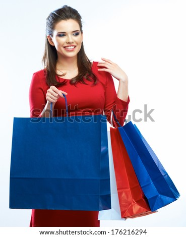 Shopping woman hold bags, portrait isolated. White background. Happy shopping girl. Red dress. female beautiful model.