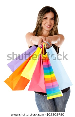 Shopping woman holding bags - isolated over white