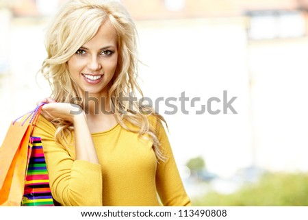 Shopping woman in autumn colors
