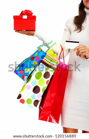 Shopping woman with bags and a credit card isolated on white background.