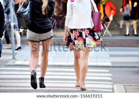Shopping women crossing street