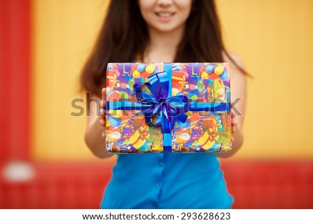 Shopping young woman with gift boxes at supermarket, happy girl with birthday present at shopping mall at sales, smiling female at birthday party with gifts, instagram style color filter,series